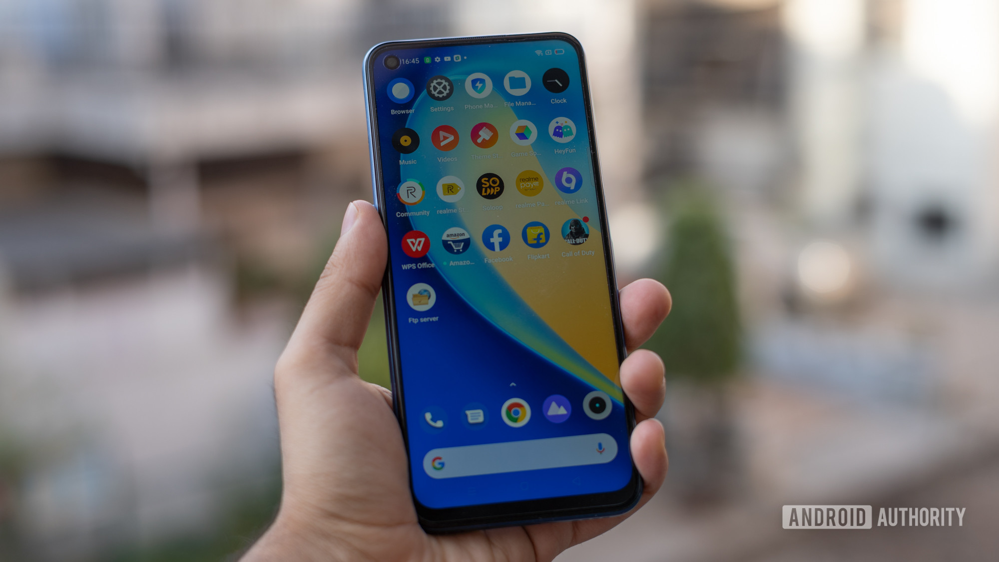 Realme Narzo 30 Pro review in hand showing display