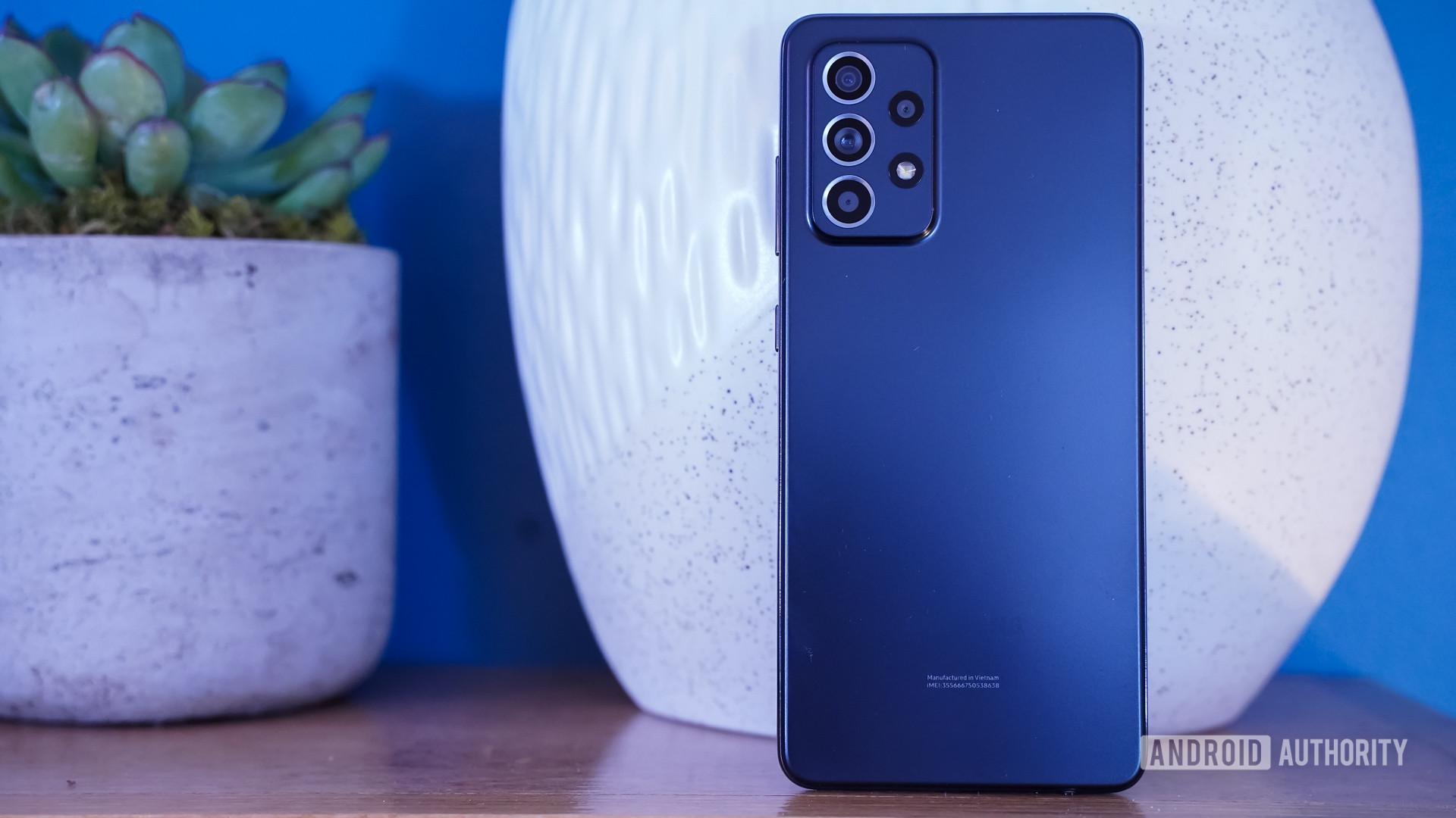 Samsung Galaxy A52 5G rear with plant