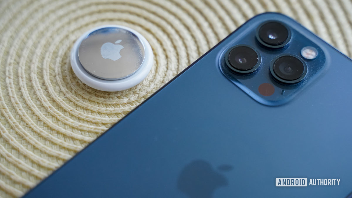 Apple AirTag with iPhone rear