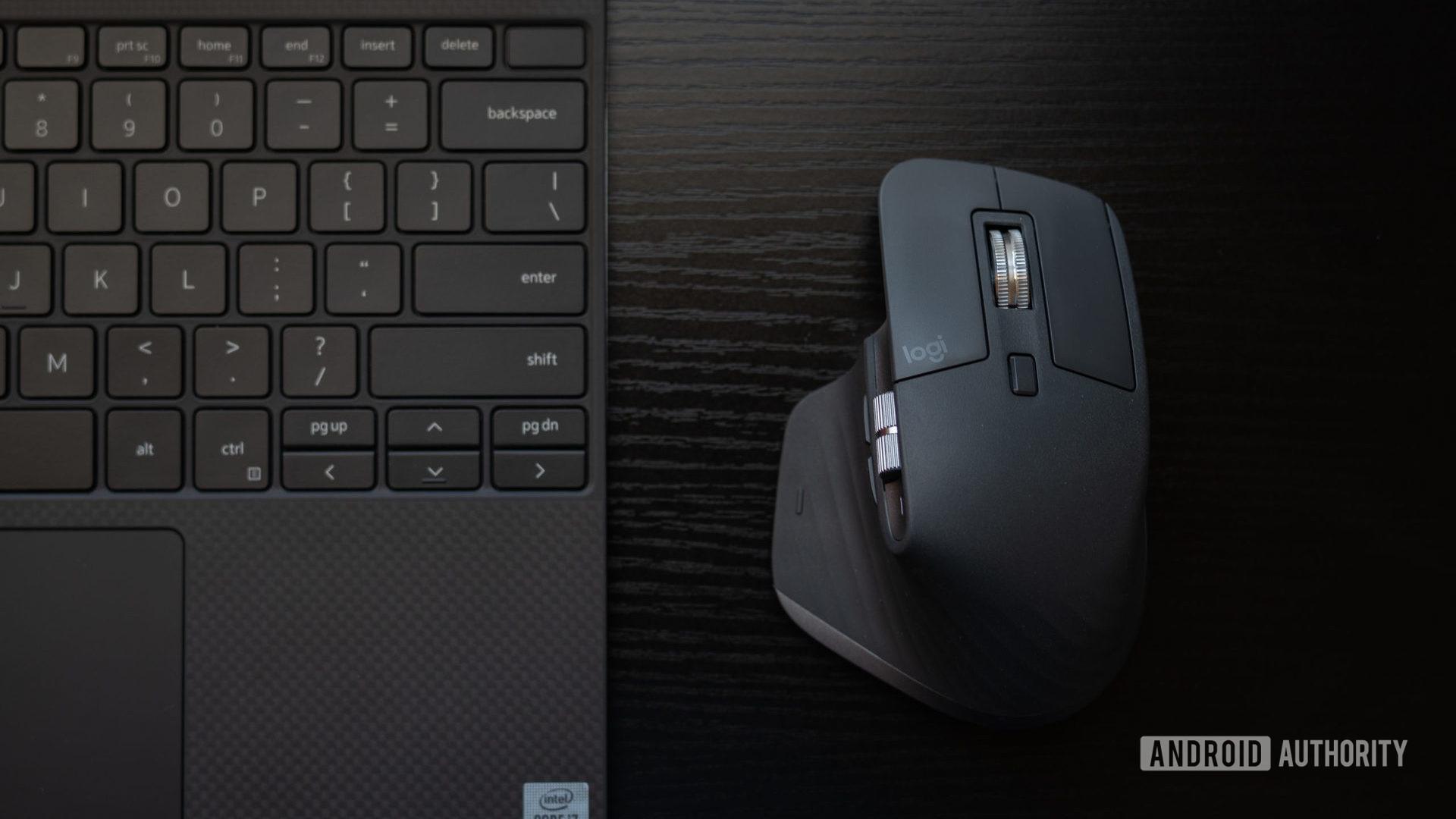 MX Master 3 beside laptop