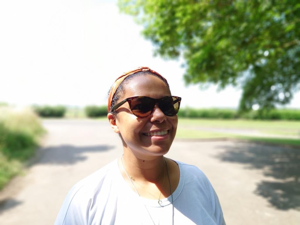 Portrait of dark skinned woman with blue skies shot on Sony Xperia 1 III