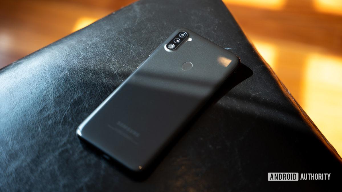 The Samsung Galaxy A11 back lying on black chair