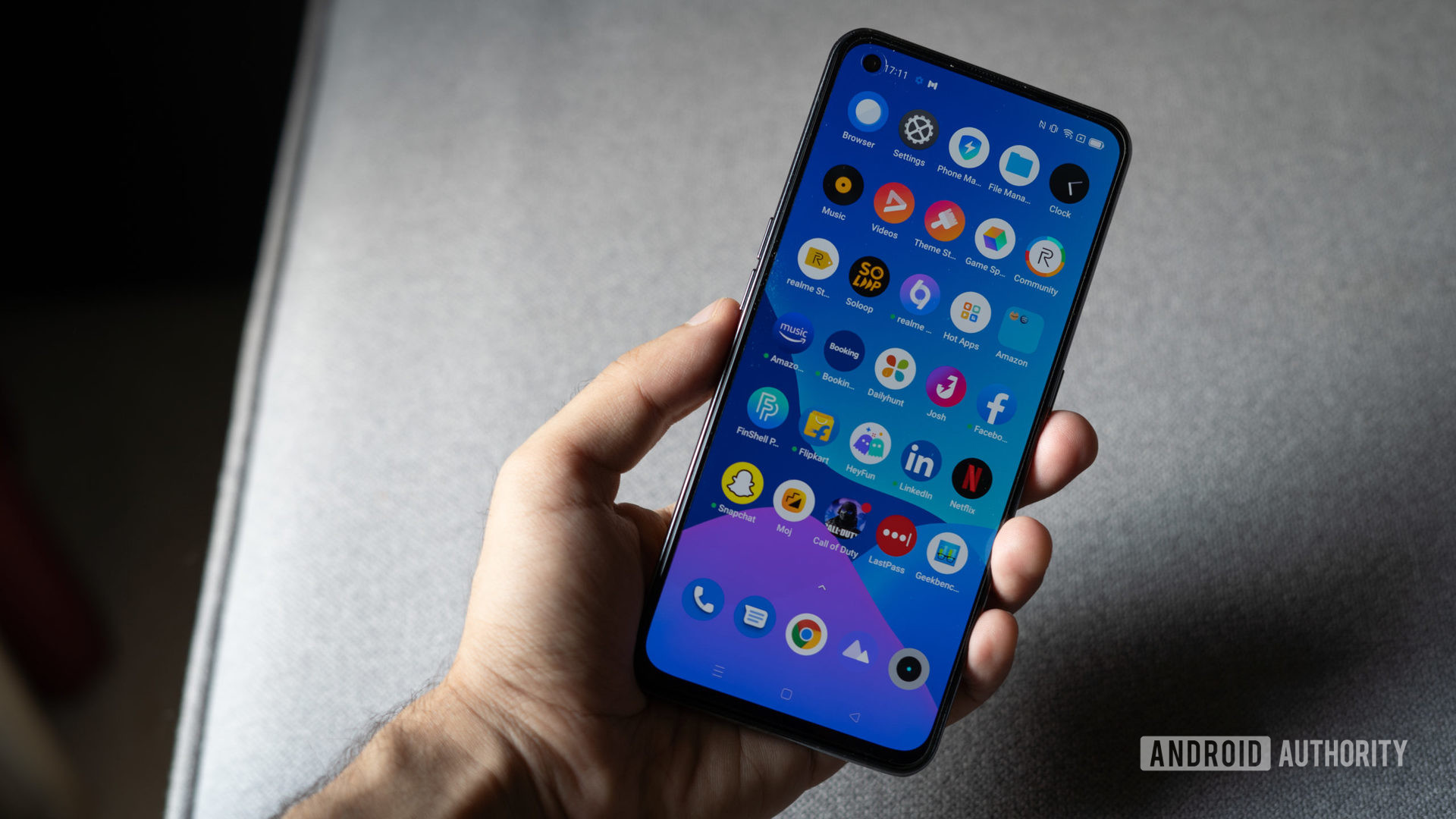 Realme GT review showing bloatware on screen.