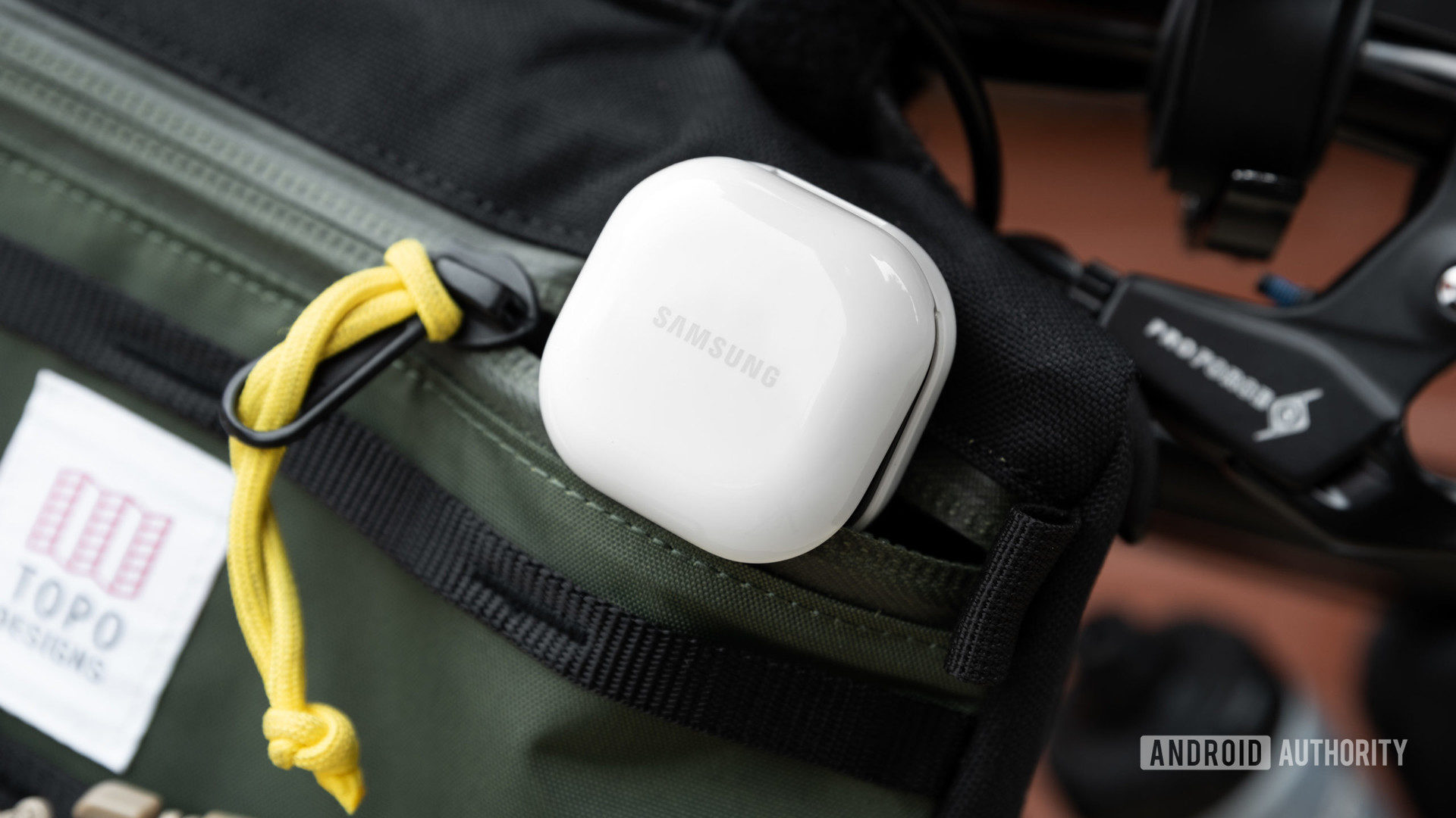 The Samsung Galaxy Buds 2 noise cancelling true wireless earbuds case partway in a zippered bag.