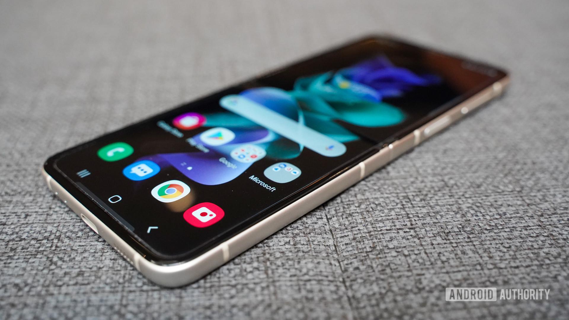 Samsung Galaxy Z Flip 3 unfolded on couch