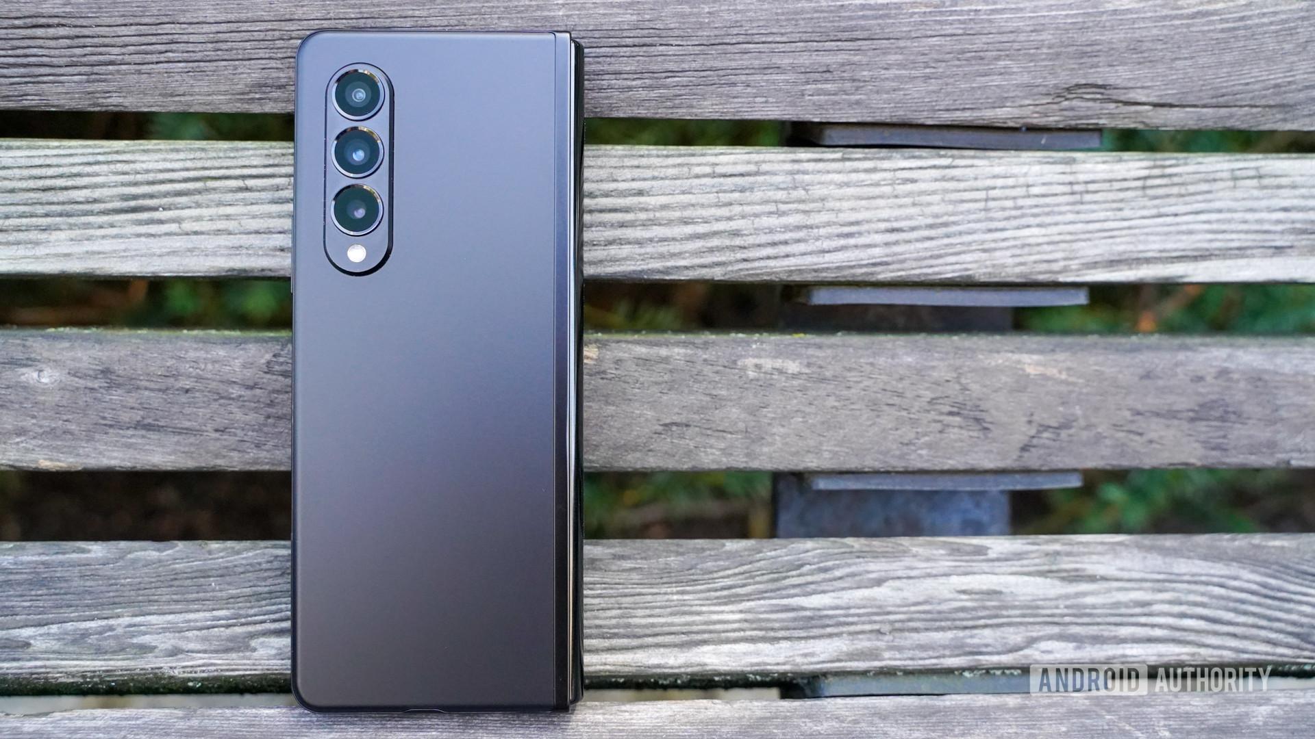 Samsung Galaxy Z Fold 3 camera rear on a bench.
