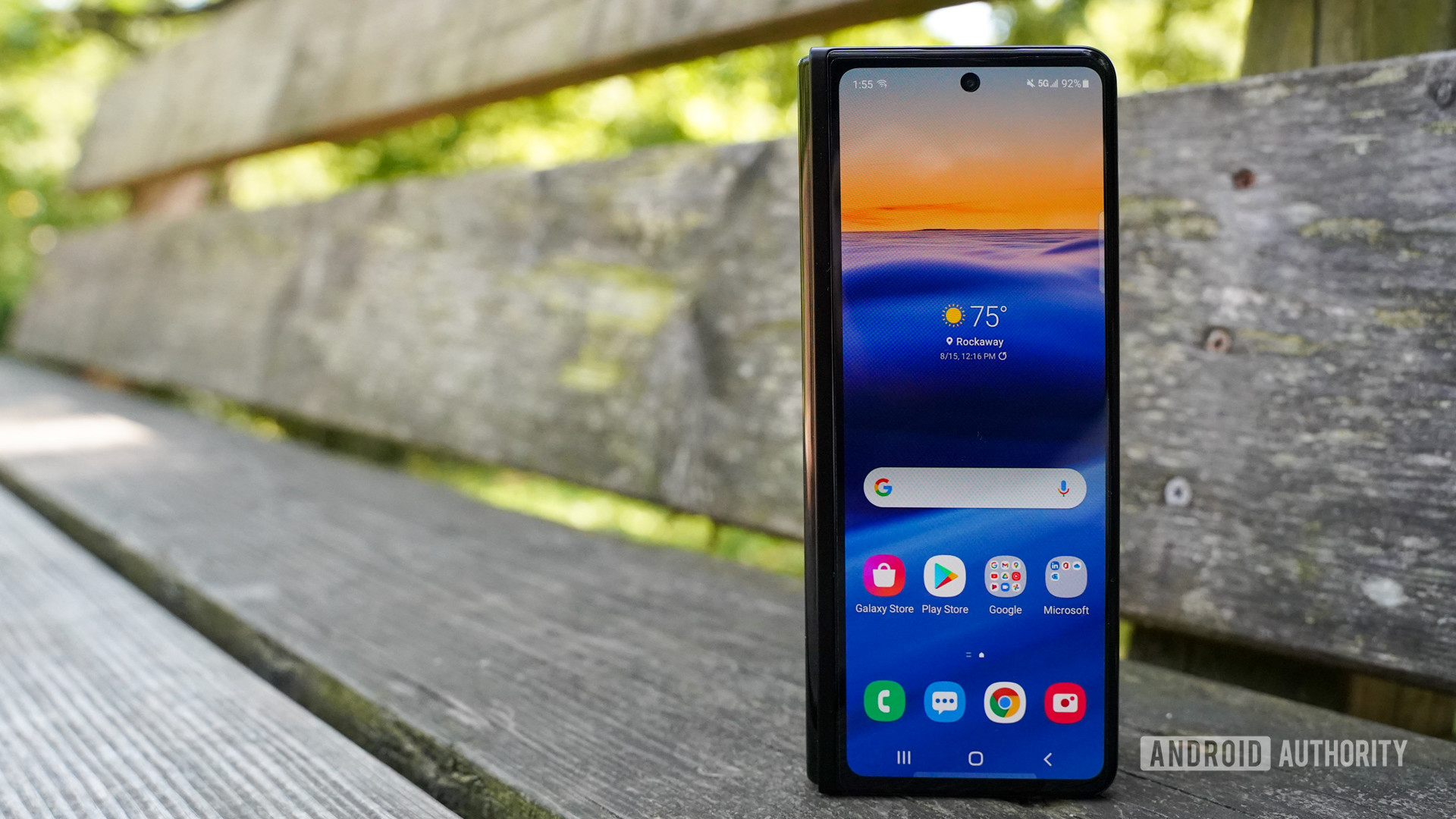 Samsung Galaxy Z Fold 3 closed front screen on a bench.