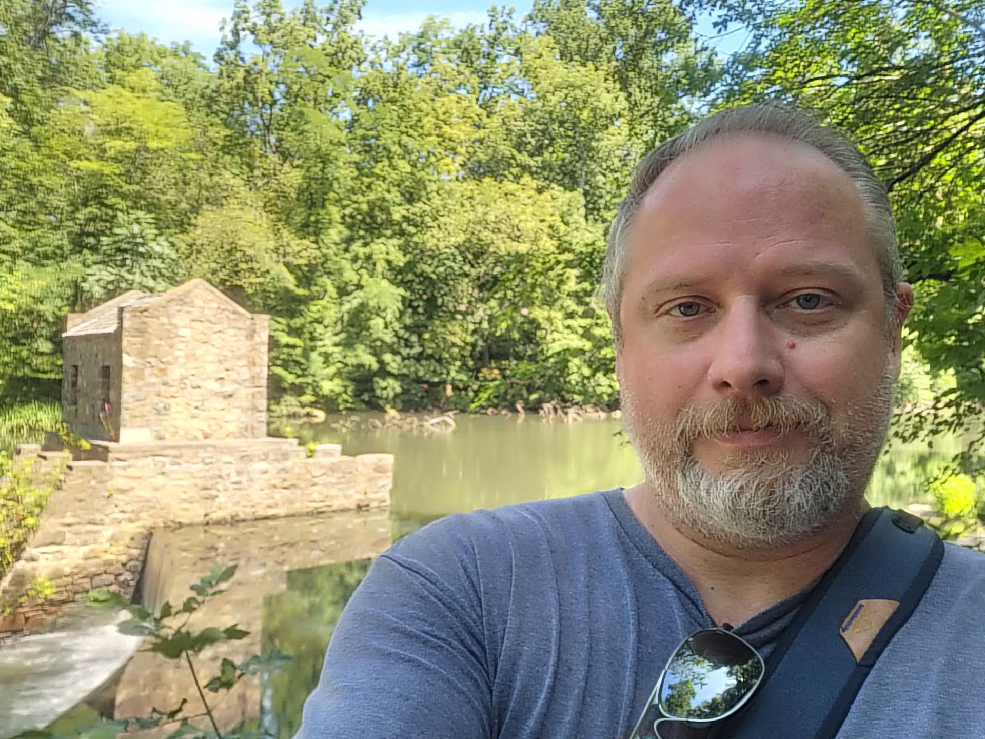 Samsung Galaxy Z Fold 3 photo sample selfie UDC of a man with a beard wearing a blue t-shirt.