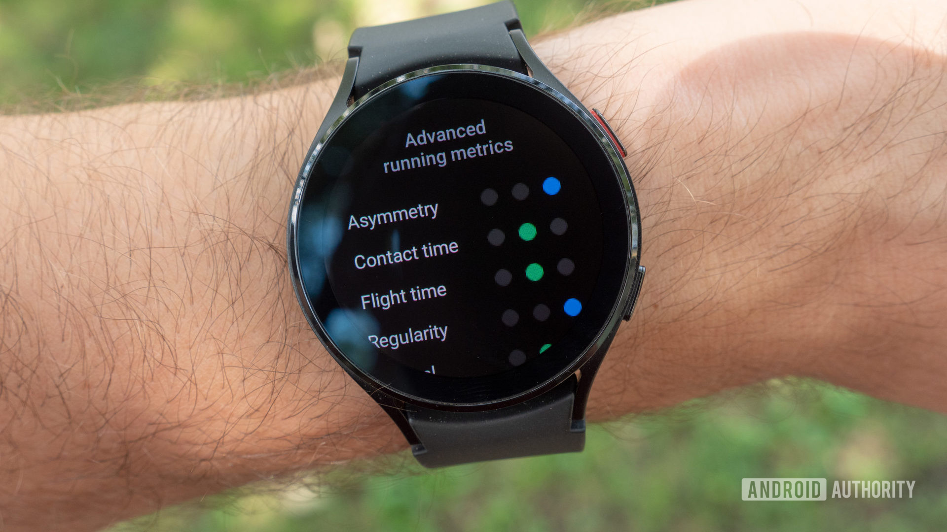 The Samsung Galaxy Watch 4 on a wrist showing advanced running metrics.