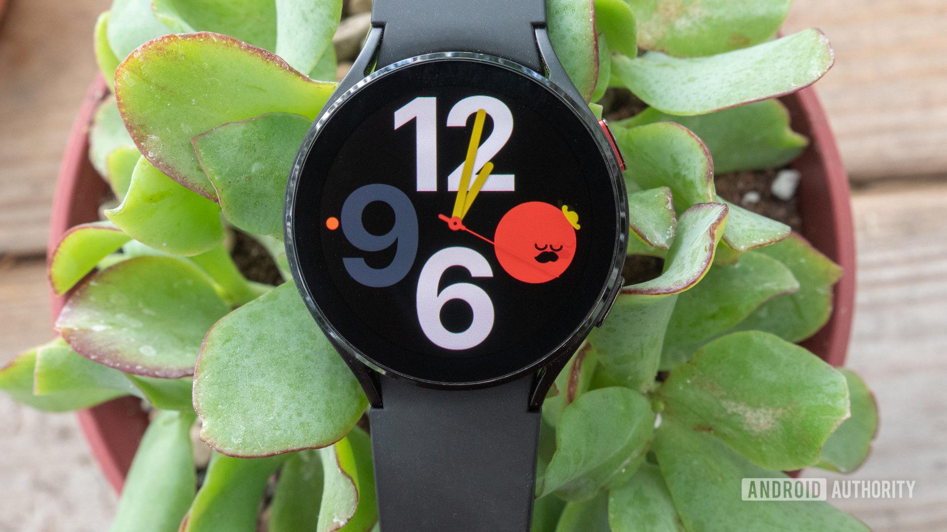 The Samsung Galaxy Watch 4 in a plant.