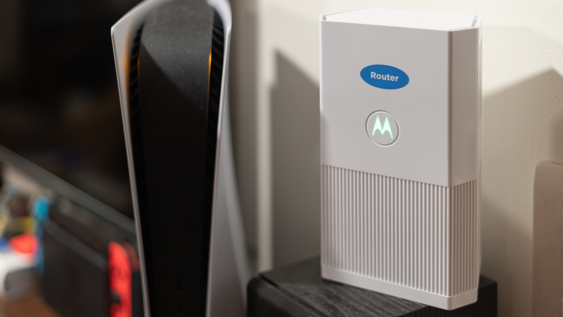 Motorola MH7020 review front profile with light on next to playstation 5