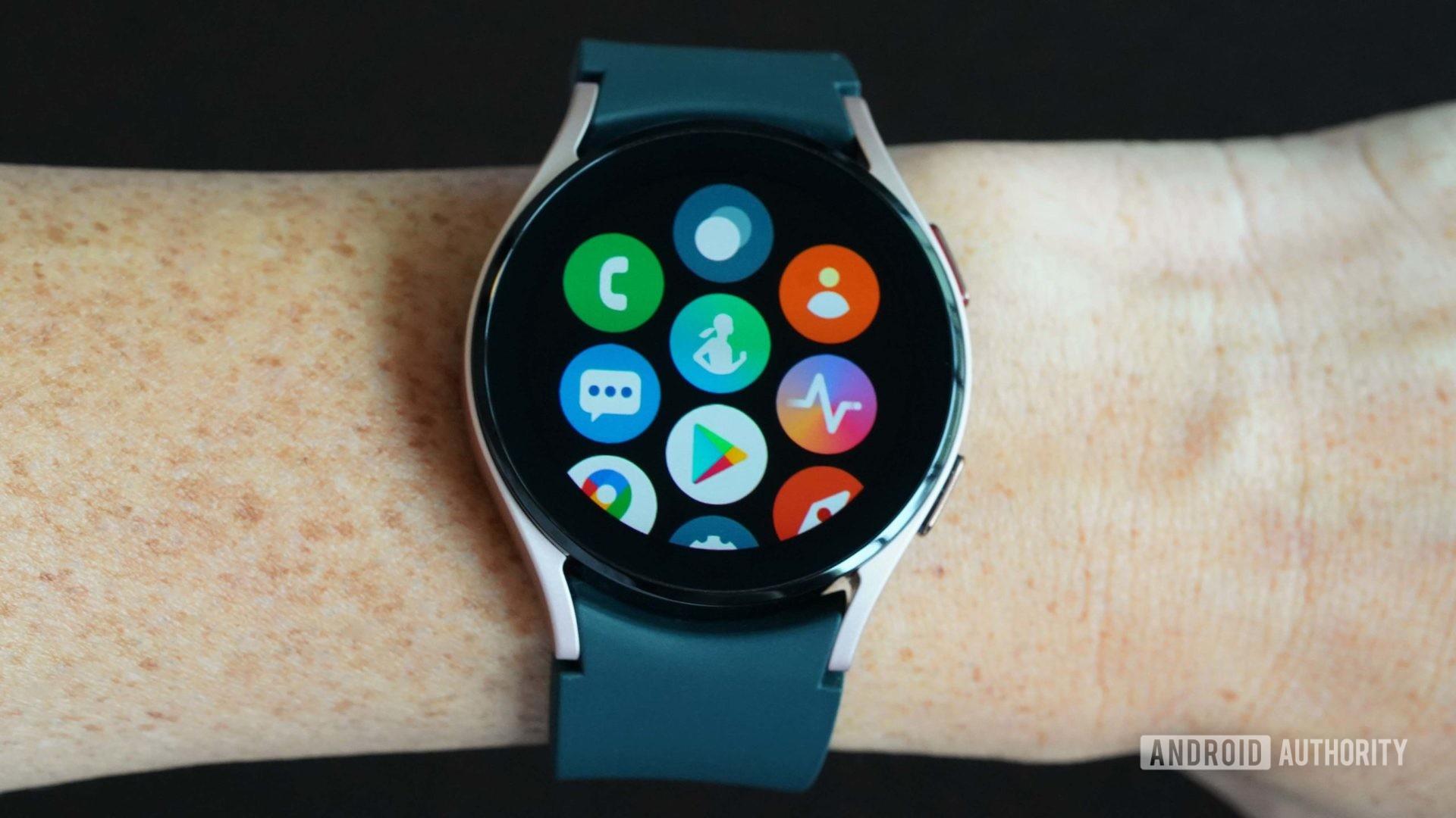 Samsung Galaxy Watch 4 displays app screen on a black background.