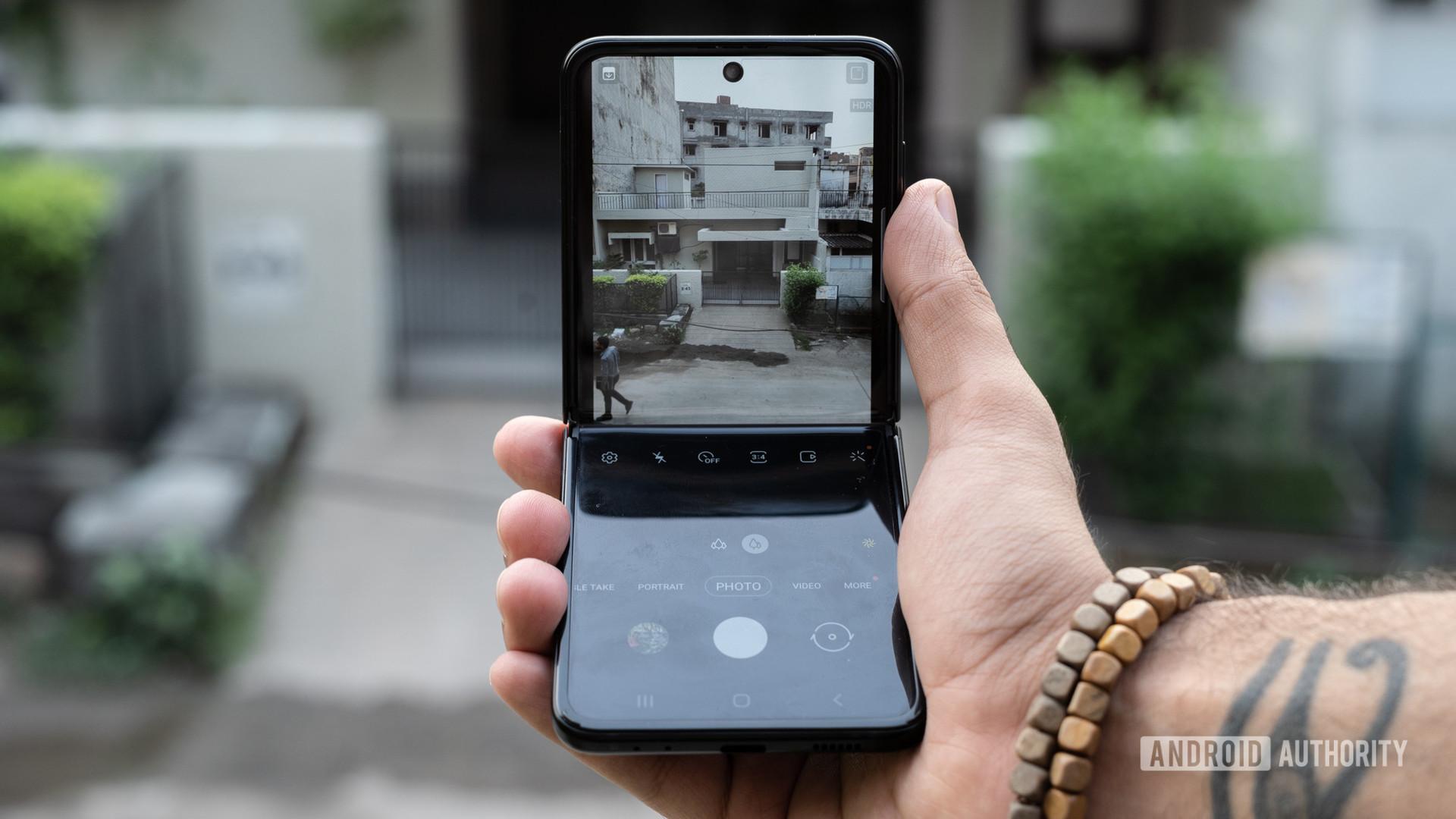 Samsung Galaxy Z Flip 3 halfway open showing camera on