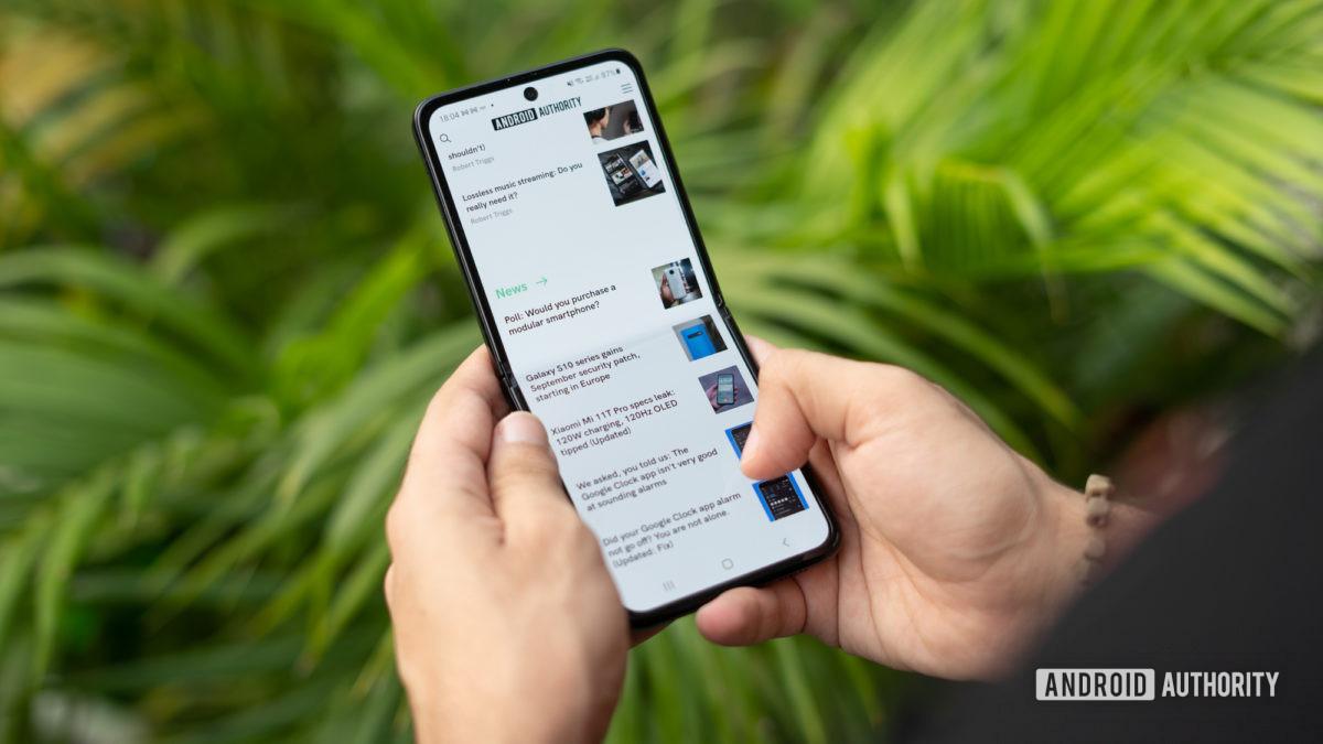 Samsung Galaxy Z Flip 3 in hand browsing the internet