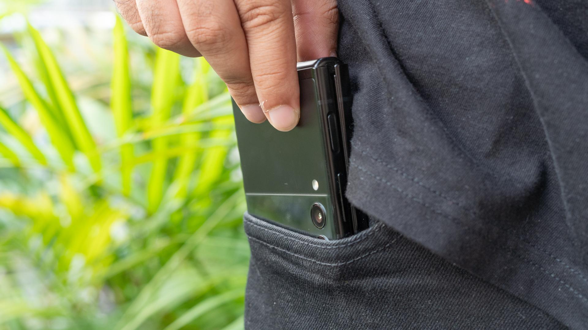Samsung Galaxy Z Flip 3 slliding phone into pocket