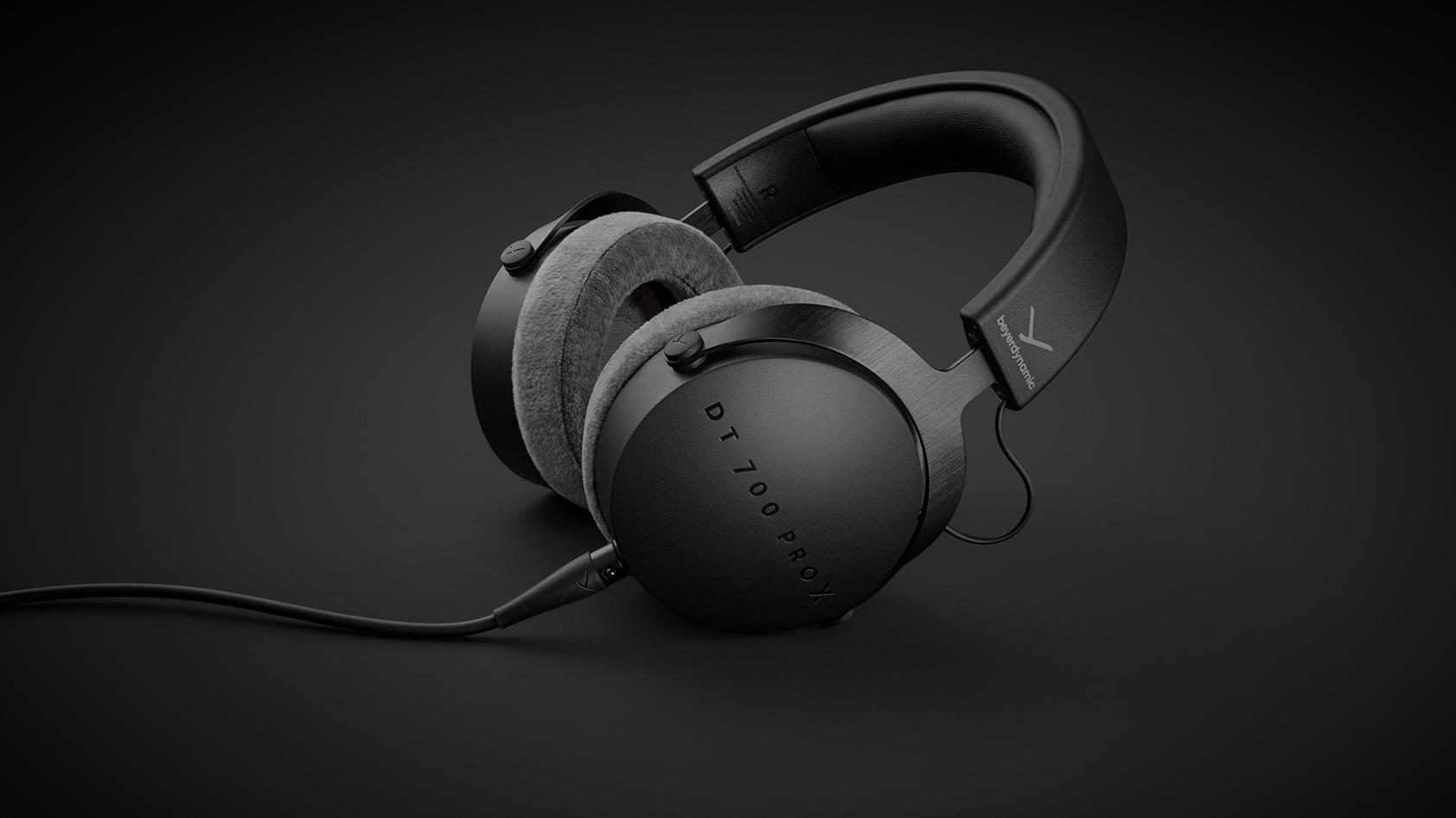 The Beyerdynamic DT 700 closed headphones against a black background.